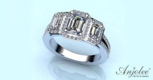 Three Emerald Diamond and Halo Surround Ring
